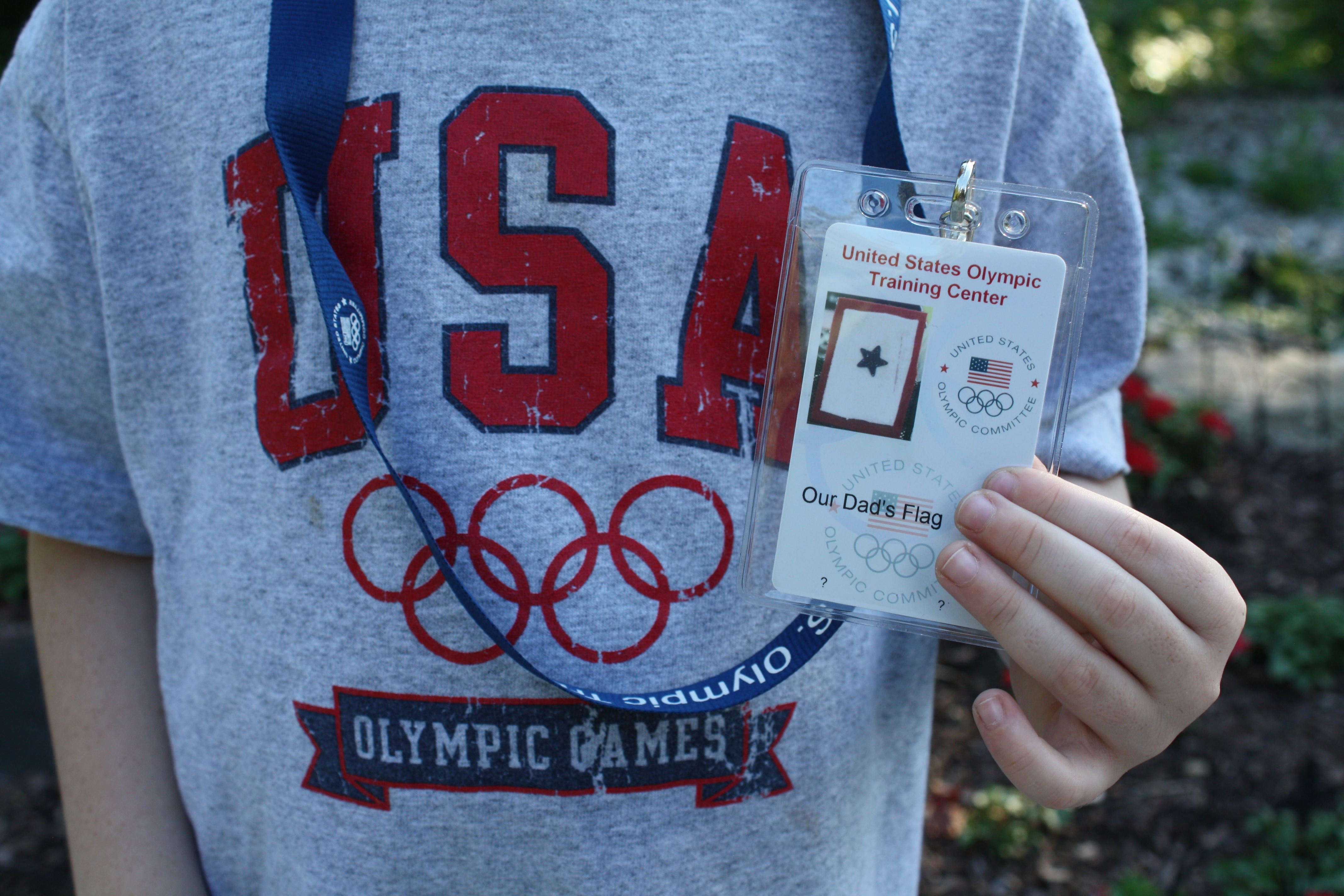 our 6 year old son holding our dad s flag official olympic training center id