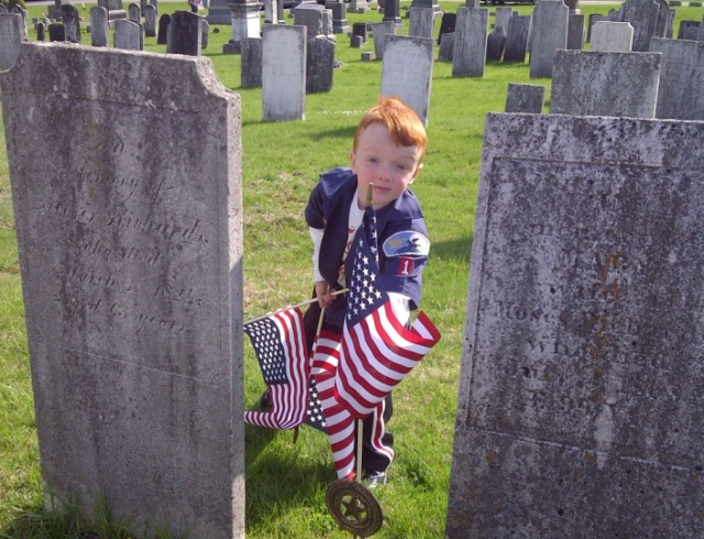 """Our Scout"" places American Flags at the local graves of Revolutionary War Veterans in honor of Memorial Day."